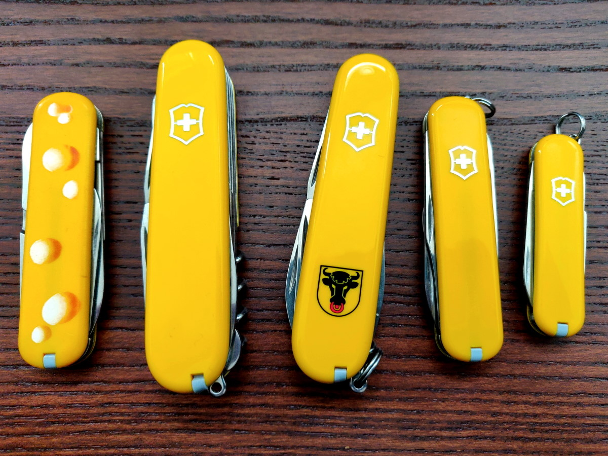 A couple of yellow Victorinox knives